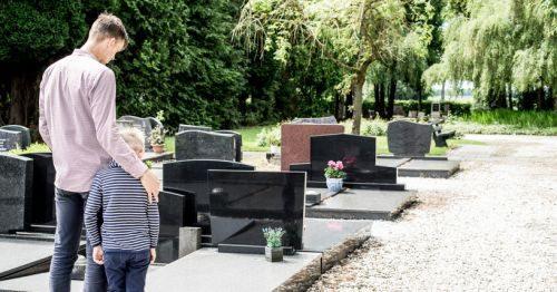 Father and Son at Grave after Wrongful Death of Family Member