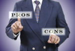Man pointing to words Pros and Cons