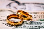 Wedding Rings on Dollars - Symbol of Postnuptial Agreement